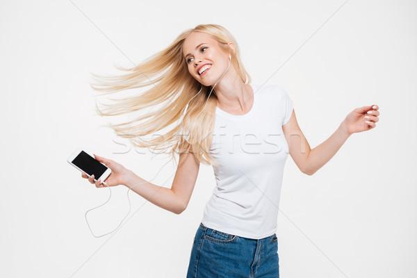 Ritratto giovani donna sorridente lungo capelli biondi ascolto Foto d'archivio © deandrobot