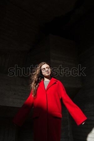 Pretty young woman standing and posing outdoors. Eyes closed. Stock photo © deandrobot