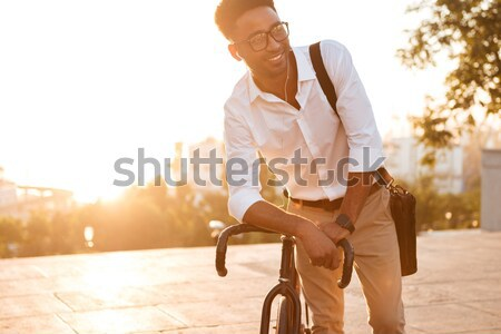 Young african man skateboarder standing Stock photo © deandrobot