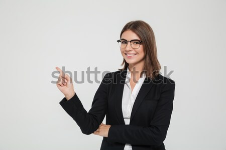 Portrait of a smiling pretty female manager in eyeglasses Stock photo © deandrobot