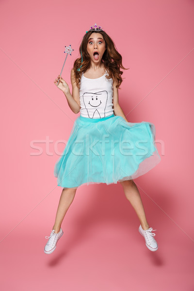 Full length photo of shocked pretty woman in crown holding magic Stock photo © deandrobot