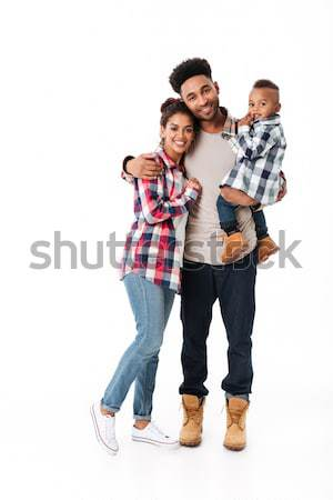 Full length portrait of a happy young african family Stock photo © deandrobot