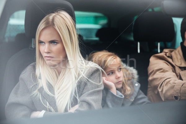 Angry displeased young family sitting in car after quarrel Stock photo © deandrobot