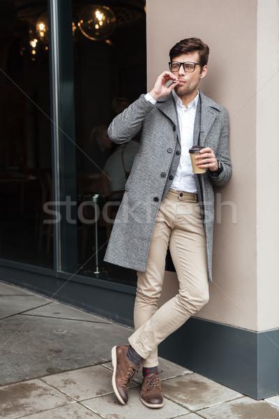 Imagem homem de negócios óculos casaco fumador Foto stock © deandrobot