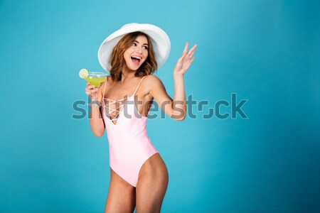 Portrait joyeux fille maillot de bain posant permanent Photo stock © deandrobot