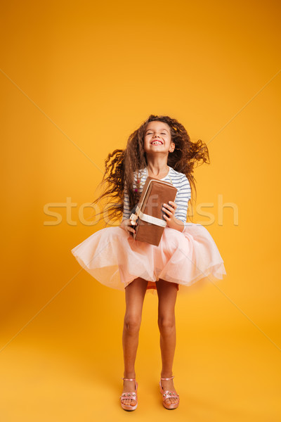 Excited emotional girl child holding gift surprise box. Stock photo © deandrobot