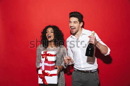 Displeased punk couple in eyeglasses with popcorn and soda Stock photo © deandrobot