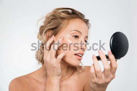 Beauty portrait of a shocked young half naked woman Stock photo © deandrobot