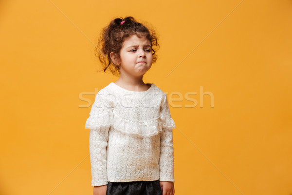 Sad little girl child cry standing isolated Stock photo © deandrobot