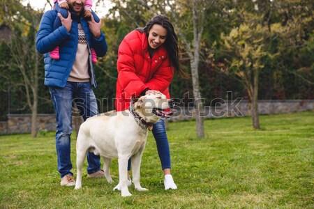 счастливая семья Лабрадор ретривер собака играет парка женщину Сток-фото © deandrobot