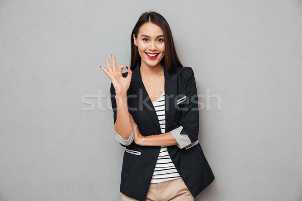 счастливым азиатских деловой женщины вызывать знак Сток-фото © deandrobot