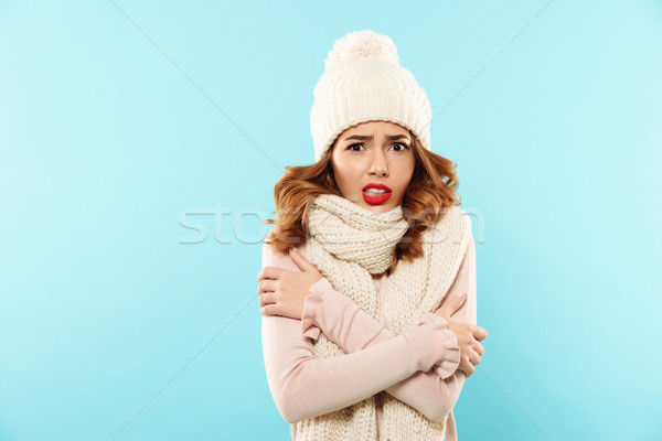 Portrait of a frozen cute girl Stock photo © deandrobot