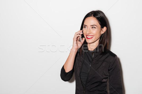 Nevet nő piros ajkak beszél mobiltelefon kép Stock fotó © deandrobot