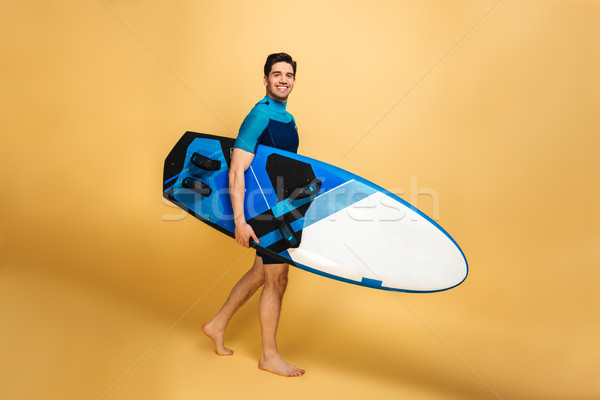 Happy young man dressed in swimsuit Stock photo © deandrobot