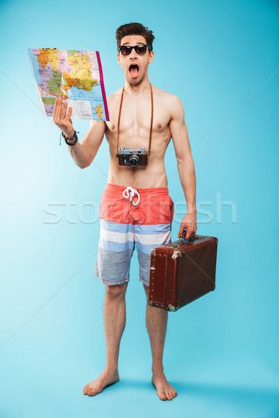 Full length portrait of a shocked young shirtless man Stock photo © deandrobot