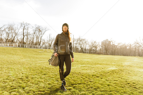 Picture of young handicapped girl with prosthetic leg in sportsw Stock photo © deandrobot