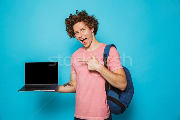 Fotó egyetem fickó göndör haj visel alkalmi ruha Stock fotó © deandrobot