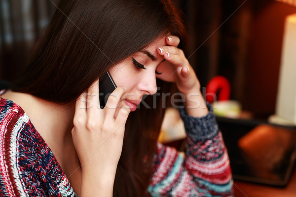 Closeup portrait of a beautiful woman talking on the phone Stock photo © deandrobot