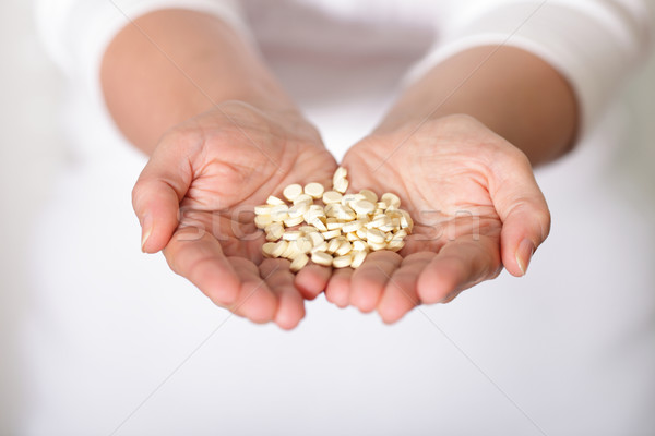 handful of pills Stock photo © deandrobot