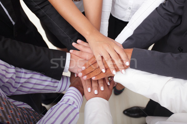 Group of business people making a pile of hands Stock photo © deandrobot