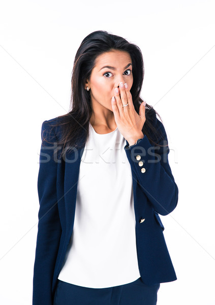 Attractive businesswoman covering her mouth Stock photo © deandrobot