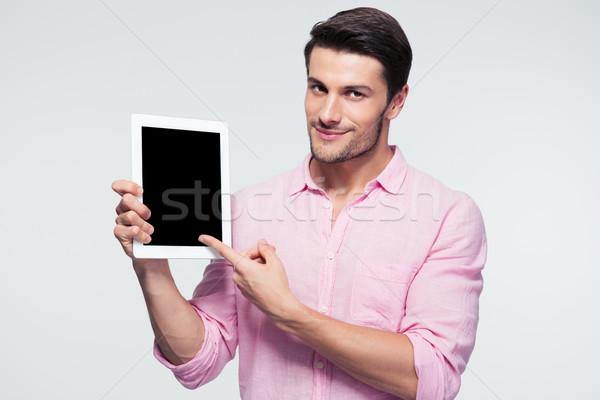 бизнесмен указывая пальца экране счастливым Сток-фото © deandrobot