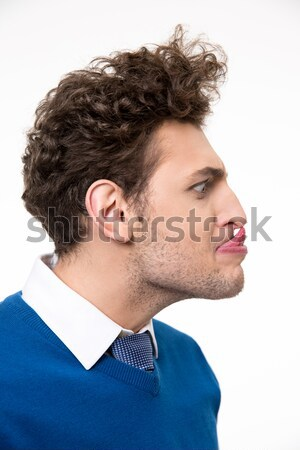 Portrait of fun man with tongue hanging out Stock photo © deandrobot