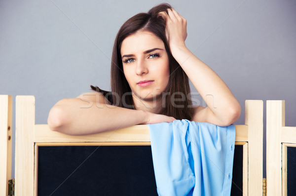 Cute woman looking out from the locker room Stock photo © deandrobot