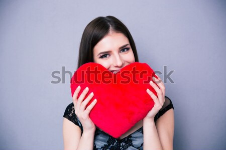Stock photo: Happy beautiful woman holding red heart