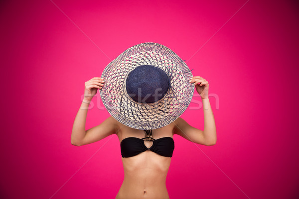 Woman in bikini covering her face with hat Stock photo © deandrobot