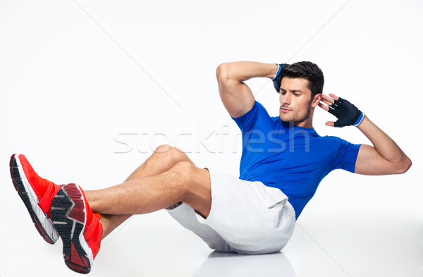 Sports man doing abdominal exercises Stock photo © deandrobot