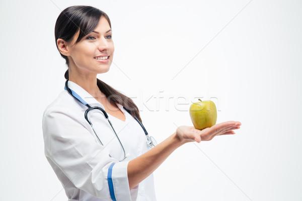 Homme médecin pomme heureux jeunes Photo stock © deandrobot