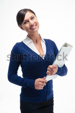Smiling businesswoman holding folder  Stock photo © deandrobot