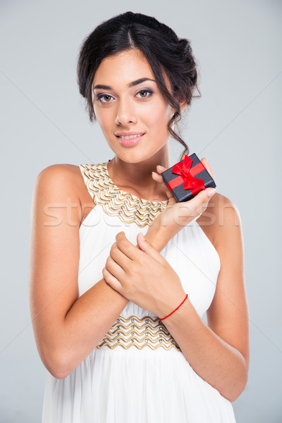 Cute woman holding jewelry gift box Stock photo © deandrobot
