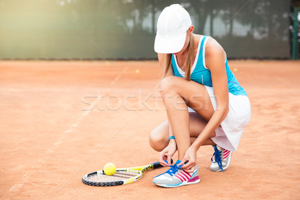 Tennis player tying shoelaces  Stock photo © deandrobot