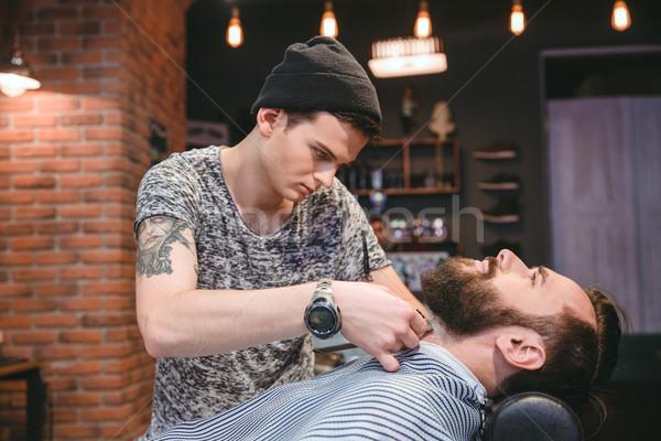 молодые парикмахера борода клиент волос парикмахерская Сток-фото © deandrobot