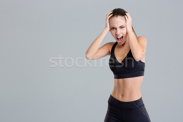Crazy hysterical shouting fitness girl in black top and leggings  Stock photo © deandrobot