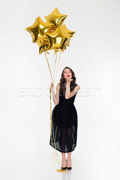 Aranyos nő csillag alakú léggömbök küldés Stock fotó © deandrobot