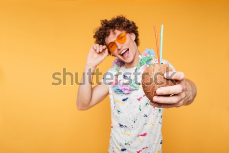 Stock photo: Surprised cute housewife in kitchen apron hiding behind uncooked spagetti