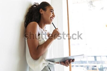 Karışık genç kadın işaret yukarı her ikisi de Stok fotoğraf © deandrobot