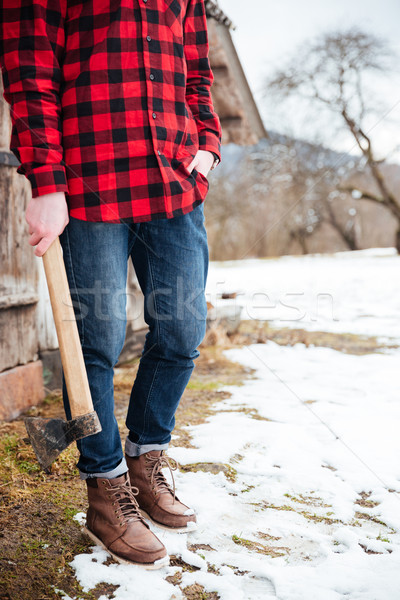 Stock photo: Man standing and holding axe in village