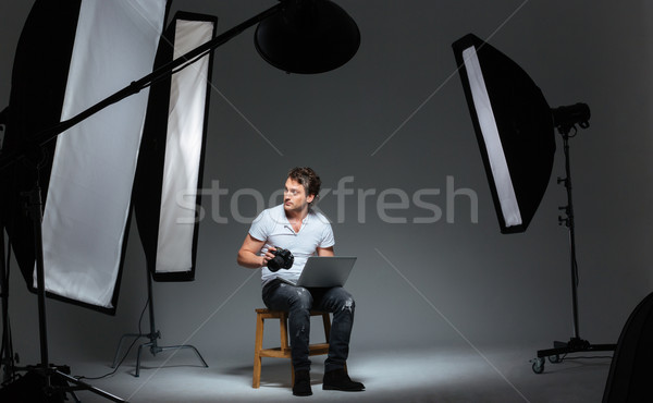Photograph sitting on the chair in professinal studio  Stock photo © deandrobot
