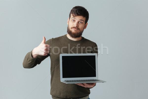 человека портативного компьютера экране большой палец руки вверх Сток-фото © deandrobot