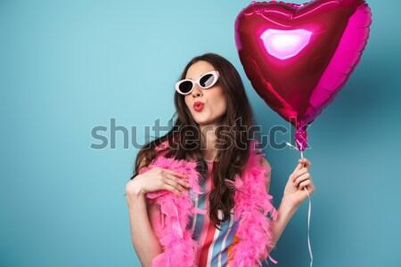 Charming stylish woman holding lollipop between tits Stock photo © deandrobot