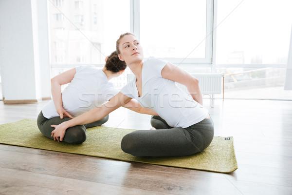 Dos mujer relajante yoga estudio Foto stock © deandrobot