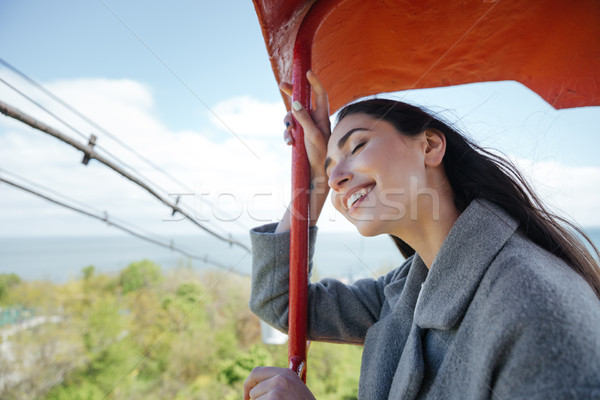 Happy young cheerful girl having fun outdoors Stock photo © deandrobot