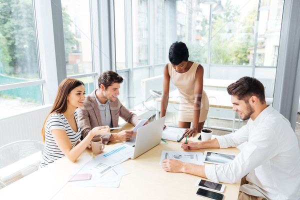 Business people discussing financial report and new project in office Stock photo © deandrobot