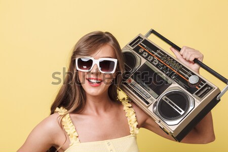Girl in sunglasses and red swimsuit holding old record player Stock photo © deandrobot