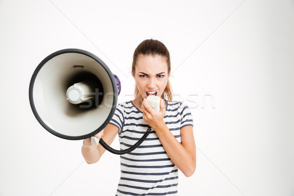 Beautiful woman shouting into megaphone Stock photo © deandrobot