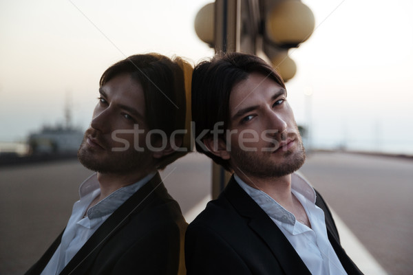 Cool businessman in port Stock photo © deandrobot